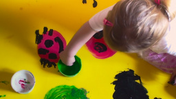 Little girl painting with hands detail Footage