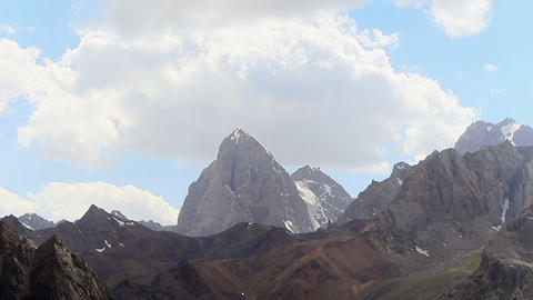 The rock beneath the clouds. Time Lapse, Pamir Footage