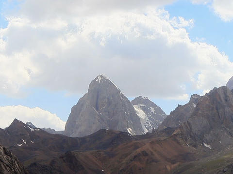 The rock beneath the clouds. Time Lapse, Pamir. 64 Footage