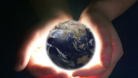 Boy Holding Earth In Her Hands, Live Action