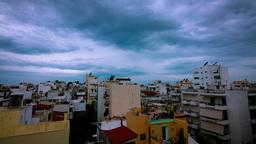 4K Timelapse Storm Rain Clouds Above City Building stock footage