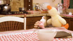 Stuffed toys bunny duck in kitchen Footage