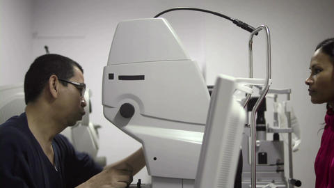 Asian Doctor At Work During Eyesight Exam To Adult stock footage