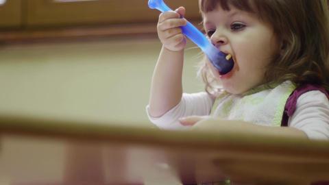 Preschooler eating lunch in classroom, baby girl, child Footage