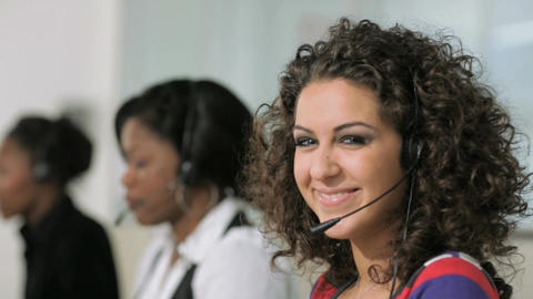 Women working as customer service representatives in call center Live Action