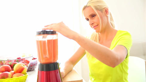 Mature Woman Preparing A Smoothie stock footage