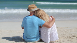 Caucasian Couple Lovers Sitting On A Tropical Beach stock footage