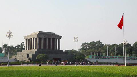 Ho Chi Minh mausoleum in Hanoi, Vietnam, Asia, Vietnamese flag Footage