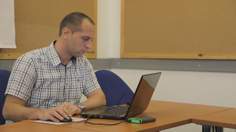 A businessman working with a stock computer Footage