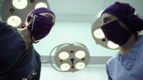 Teamwork With Nurse And Surgeon Performing Surgery stock footage