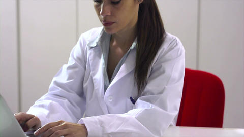Portrait of mid adult woman smiling at work as doctor Live Action