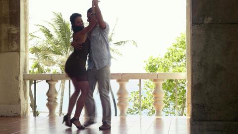Young hispanic couple dancing latin american dance Footage