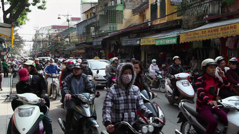 Scooters, motorcycles, bicycles, traffic and people driving in Hanoi, Vietnam Footage
