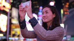 Young Asian Woman In City At Night Taking A Selfie Photo Picture stock footage