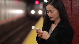 Asian Woman Texting Smart Phone Cell Phone In Subway Station stock footage