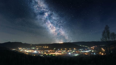 Milky Way over mountain town Footage