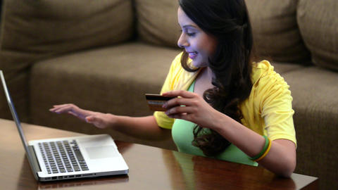 Locked-on Shot Of A Woman Shopping Online With A L stock footage