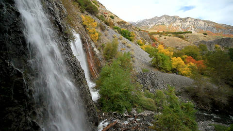 Waterfall With Fall Color And Mountain stock footage