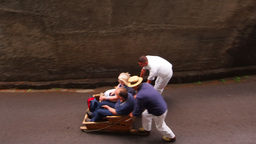 Wicker Toboggan Sled Ride On Madeira, Portugal stock footage