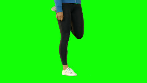 Fit Woman Standing And Stretching Her Legs stock footage