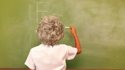 Cute pupil writing maths on chalkboard Footage