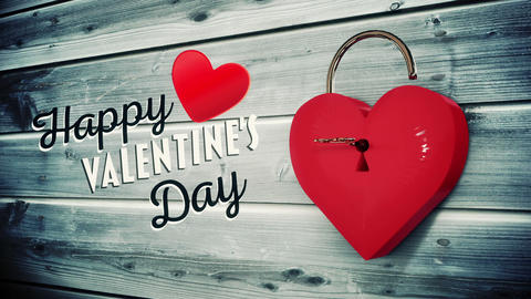 Key opening a heart lock with valentines message Stock Video Footage