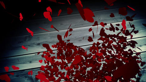 Red hearts falling on wooden surface Animation