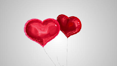 Heart balloons floating against grey background Animation