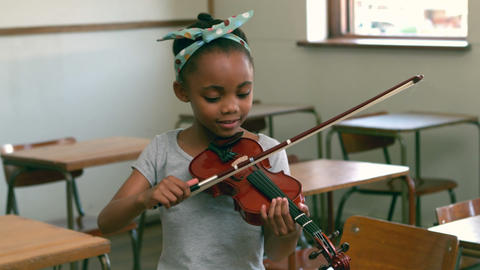 Cute Pupil Playing Violin In Classroom stock footage