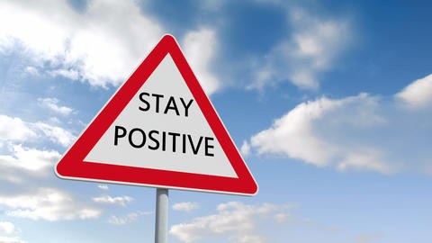 Stay positive road sign over cloudy sky Animation