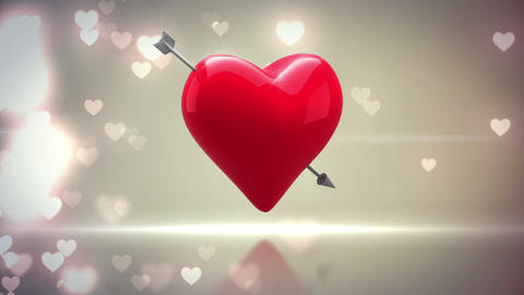 Red heart with an arrow turning on glittering background Animation