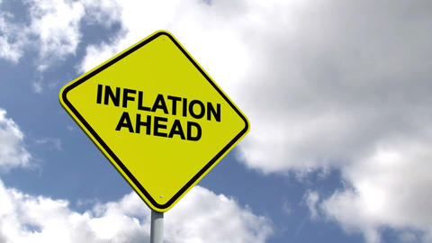 Inflation Ahead Sign Against Blue Sky stock footage
