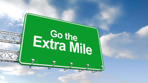 Go the extra mile sign against blue sky Animation