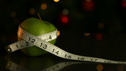 Apple Wrapped In Measuring Tape stock footage