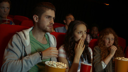 Friends Watching Movie In Cinema stock footage