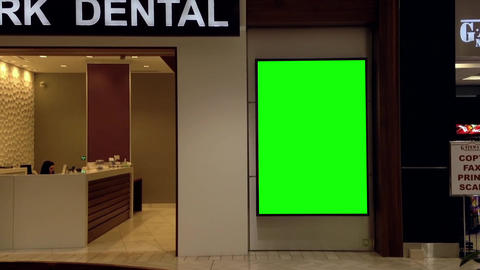 Green billboard for your ad beside of dental clini Footage