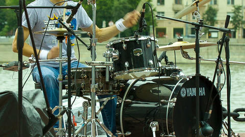 Drummer playing at a concert in the street, shot i Live Action