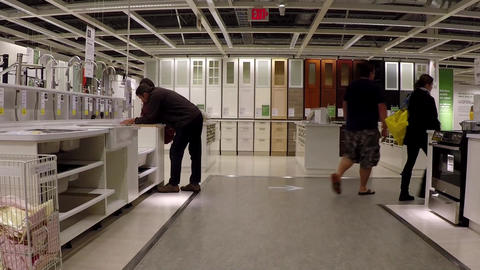 Customer shopping sink inside Ikea store with wide Live Action