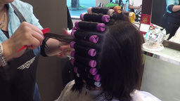 People having a perm in a hairdressing salon with  Footage