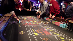 Dice rolling across a craps table Footage