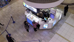Top shot of people buying lottery ticket inside ma Live Action