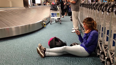 Women reading mobile phone message with luggage sp Live Action