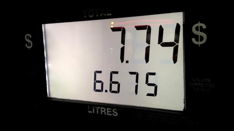 Close up rising gas prices on station pump screen Footage