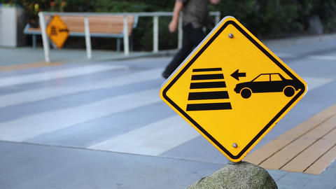 Pedestrian crossing traffic sign attention for car Footage
