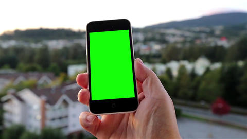 Man holds a blank smart phone with a green screen  Footage