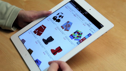 Close up woman shopping new sock and shoes on ipad Footage
