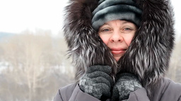 Woman wrapped in a fur collar because of cold Footage