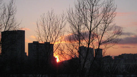 Timelapse.Sunset over buildings in winter Footage