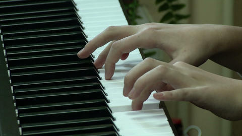 playing a musical instrument piano- large fingers Live Action