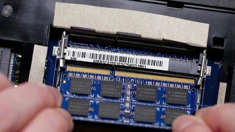 Man installing a ram into laptop Footage